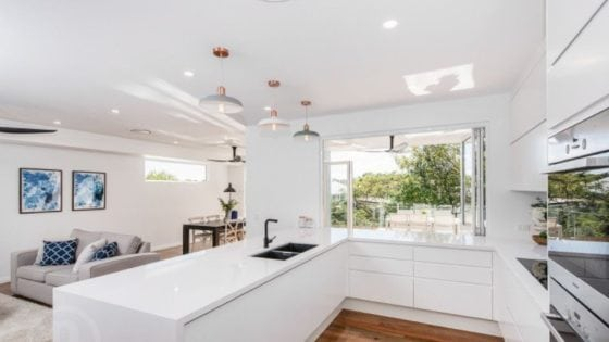 kitchen with timber flooring and white benchtops