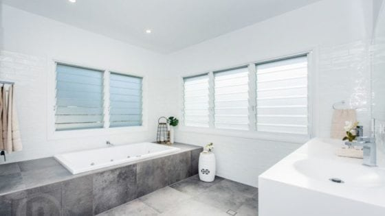 new bathroom with white walls and dark grey tiles