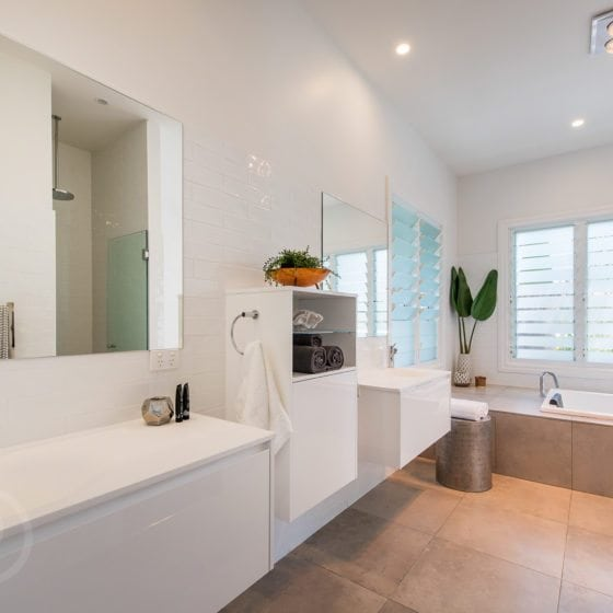 large new bathroom with white walls and grey tiles