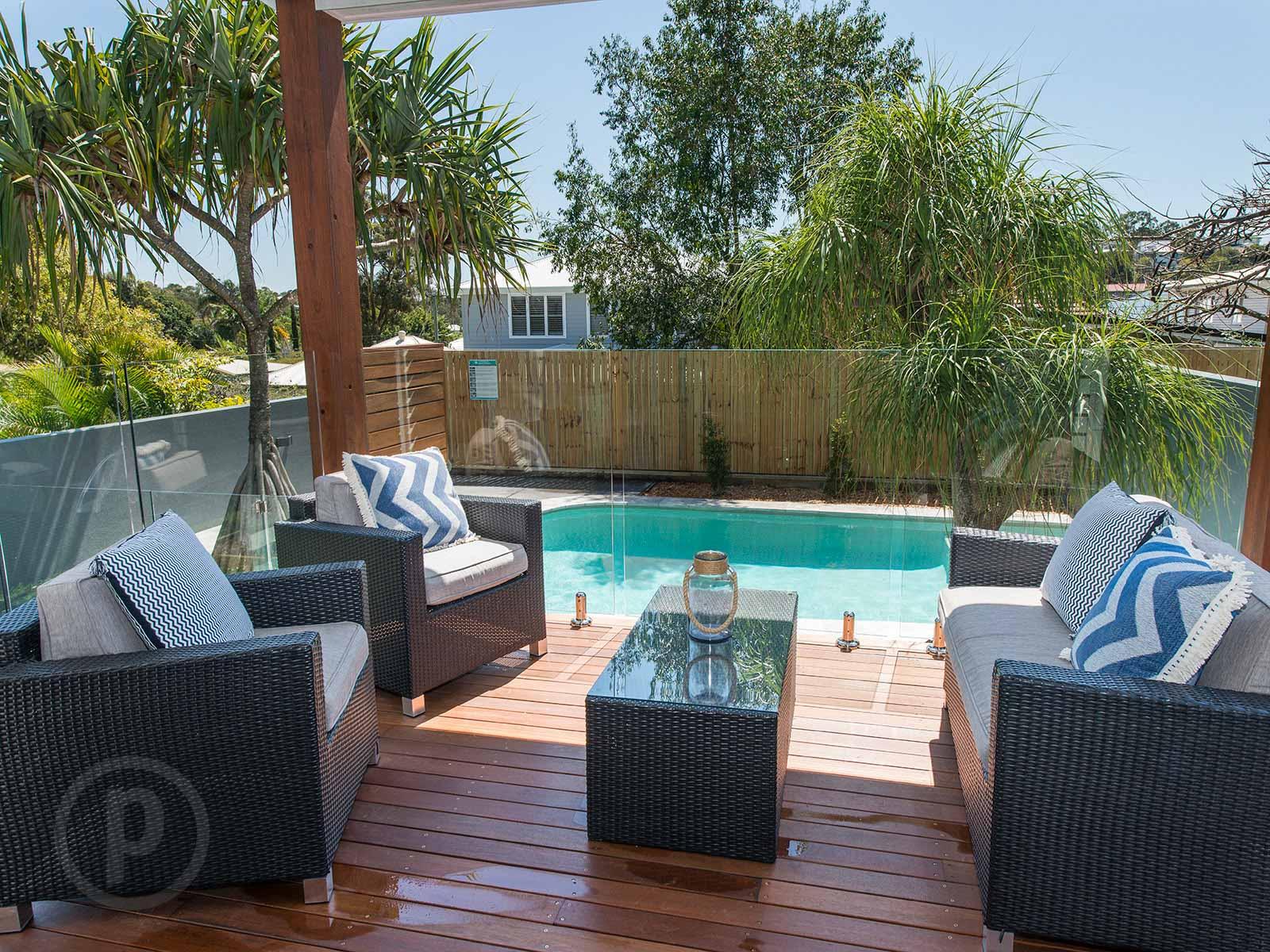 amazing builds back deck overlooking pool