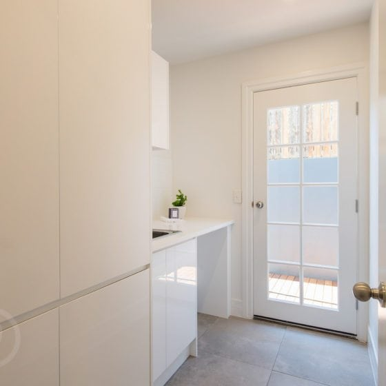 laundry room with white walls
