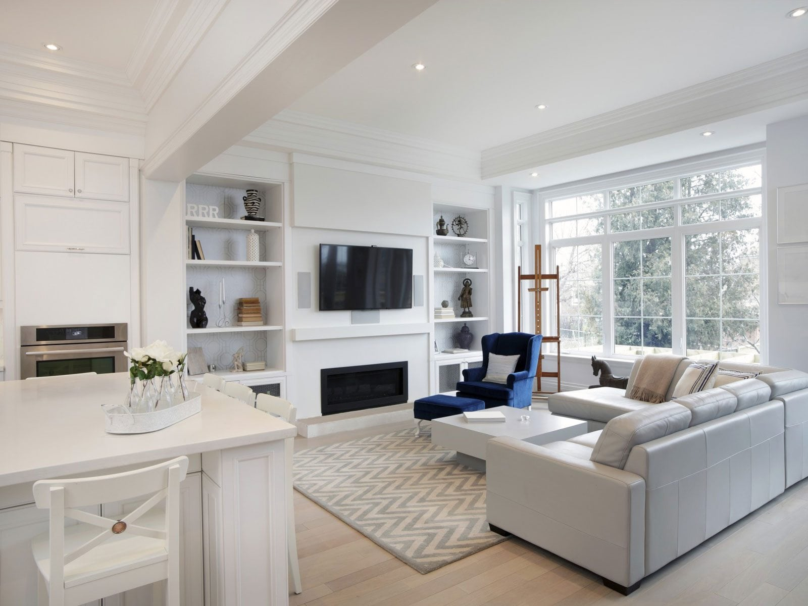 open plan living white and grey styled home