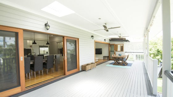 long white covered deck with dining set