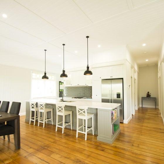 kitchen dining with island and white chairs