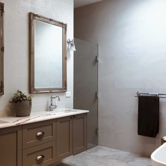 grey bathroom with dual sink